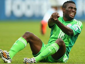 Nigeria's Michael Babatunde reacts after breaking his arm. (Getty)