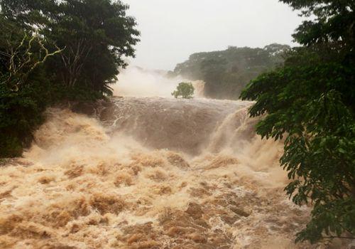 The flooded Wailuku River near Hilo, Hawaii, after the hurricane made landfall.