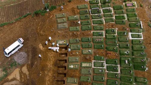 Coffins are buried at an expanding cemetery in Sumatra, Indonesia.
