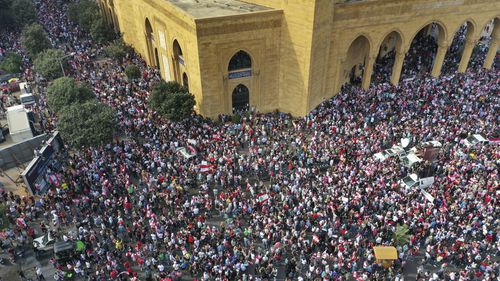 An aerial view shows tens of thousands of anti-government protesters, in downtown Beirut, Lebanon, Sunday, Oct. 20, 2019.