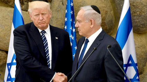 US President Donald Trump and Israeli President Benjamin Netanyahu shake hands during a visit to the Yad Vashem Holocaust Memorial museum in Jerusalem in May 2017. (AAP)