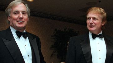 Robert Trump, left, joins real estate developer and presidential hopeful Donald Trump at an event in New York (Photo: Nov. 3, 1999)