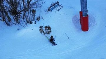 A skier sits dazed in the snow after their chairlift fell 5m from a cable.