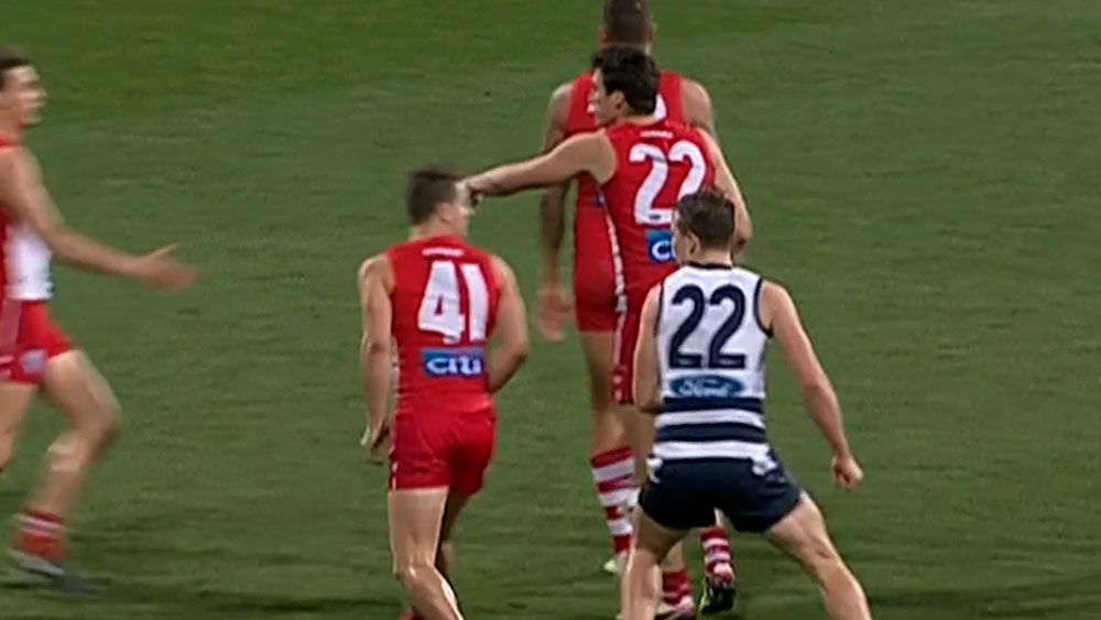 Geelong's Mitch Duncan sizes up Sydney's Tom Papley. (Fox Sports)
