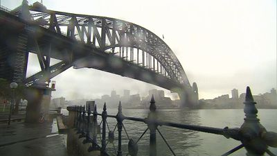 Rain comes down over Sydney Harbour Bridge