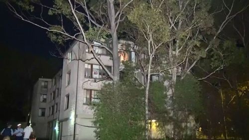 A wooden balcony railing on this unit block gave way. (9NEWS)
