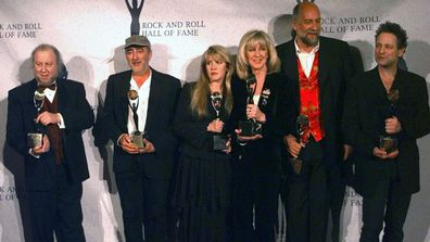 Members of Fleetwood Mac hold their awards after the group was inducted into the Rock and Roll Hall of Fame, in New York. From left, are: Peter Green; John McVie; Stevie Nicks; Christine McVie; Mick Fleetwood; and Lindsey Buckingham. (Photo: Monday, Jan. 12, 1998)