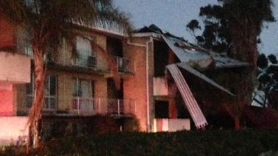 Strong gusts tore a roof off apartments in Attadale. (9NEWS)