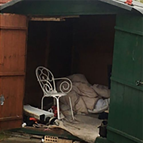 A photograph provided by the GLAA whihc rescued the man from the shed showed a small green garden shed with little inside but a duvet, a television, an electric heater and a scrap of carpet.