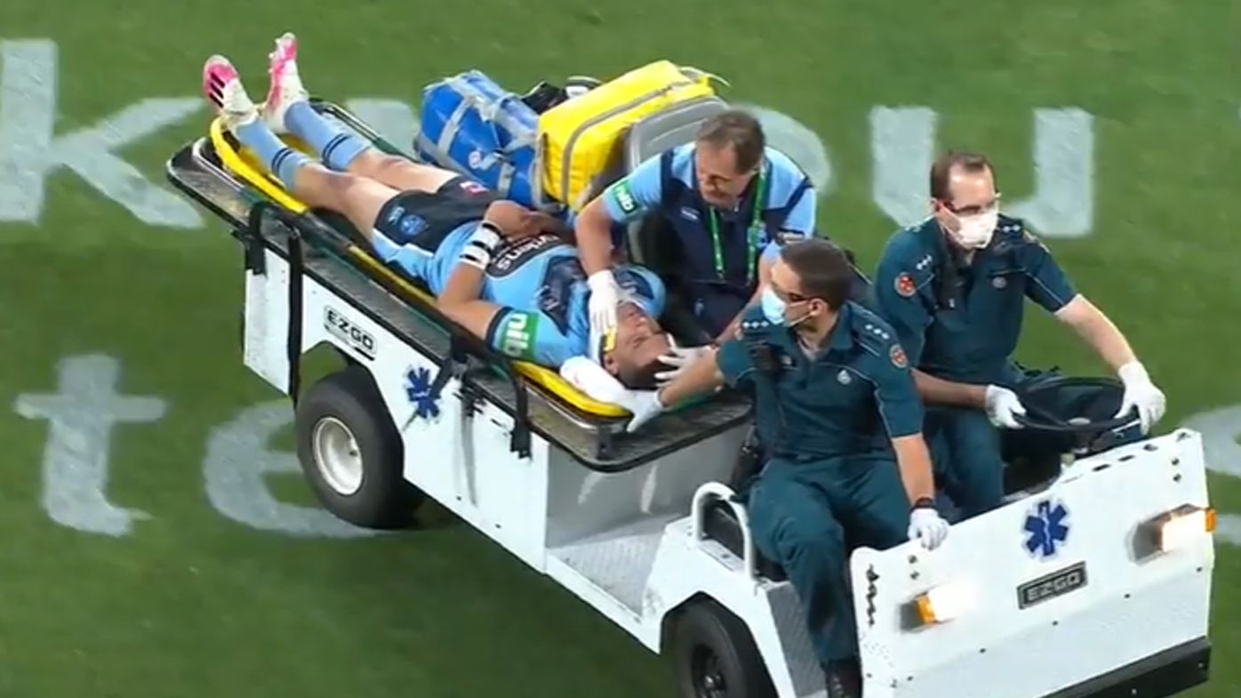 Cody Walker is taken from the field in a medicab