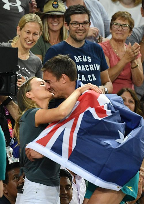 Brandon Starc celebrates his gold with girlfriend Laura Turner. (AAP)