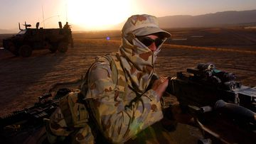 An Australian soldier on patrol near a Forward Operating Base (FOB) in Afghanistan, in 2006.