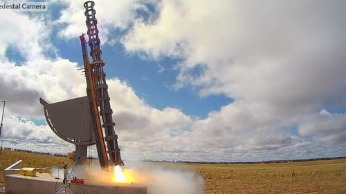 The rocket blasts off.