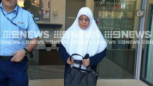 Maha Al-Shennag emerges from Bankstown police station.
