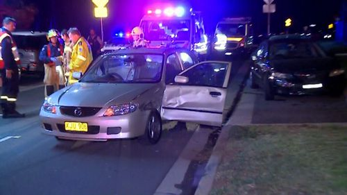 Mazda 323 took the roundabout on the wrong side of the road and slammed into three parked cars. Picture: 9NEWS