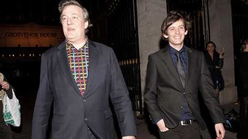 Stephen Fry and Elliott Spencer on March 30 last year. (Getty)