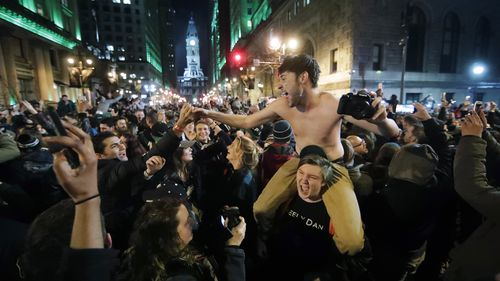 Philadelphia Eagles fans celebrate the team's victory in NFL Super Bowl 52 between the Philadelphia Eagles and the New England Patriots. (AAP)