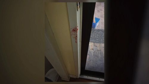 Photos of the damage show bloodstains on the walls.