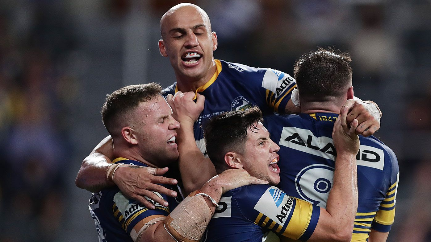 Reed Mahoney of the Eels celebrates scoring a try with team mates during the round 1 NRL match between the Parramatta Eels and the Canterbury Bulldogs