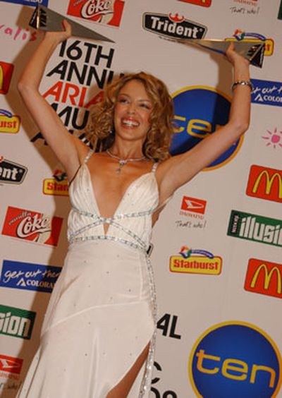 Kylie clutching her trophies at the 2002 ARIA Awards.