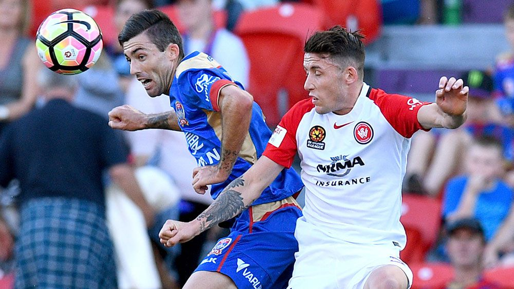 Newcastle's Jason Hoffman and Wanderers' Scott Neville contest and header during their A-League clash. (AAP)