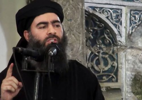This image was released by Islamic State in 2014, purporting to show the leader of the Islamic State group, Abu Bakr al-Baghdadi, delivering a sermon at a mosque in Iraq during his first public appearance.