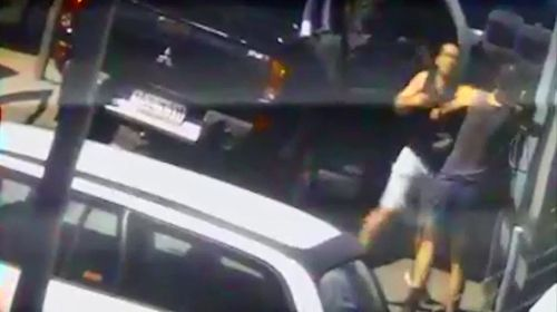 Security footage shows the two men fighting.