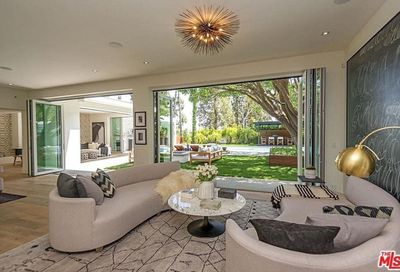 A bright and open floor plan with south-facing public rooms all opening to the outside, offers green views from every room.