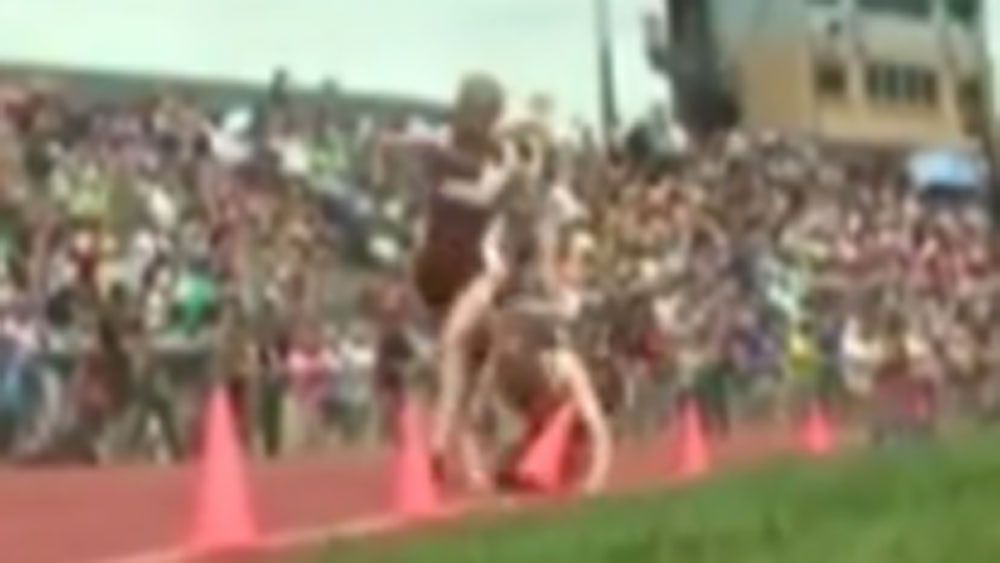 College runner pushes over rival