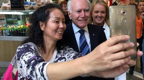 John Howard campaigning in Penrith yesterday with Liberal MP Fiona Scott (right). (AAP)