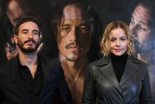 Actors Abbie Cornish, right, and Ryan Corr pose for photographs during a media preview of the 'Heath Ledger: A Life In Pictures' exhibition at the National Film and Sound Archive of Australia (NFSA) in Canberra. (AAP).