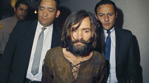 In this 1969 photo, Charles Manson is escorted to his arraignment on conspiracy-murder charges in connection with the Sharon Tate murder case.
