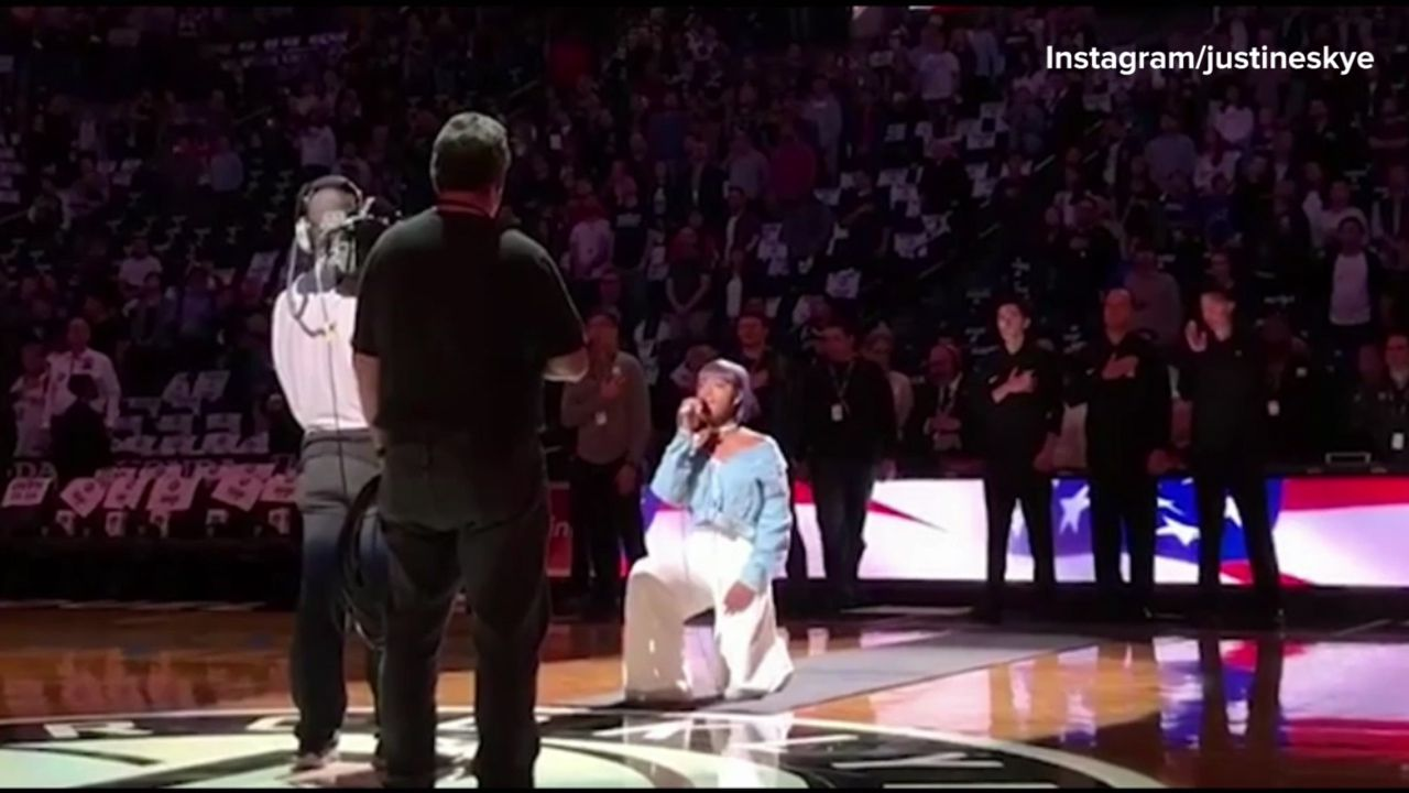 National Anthem singer takes a knee