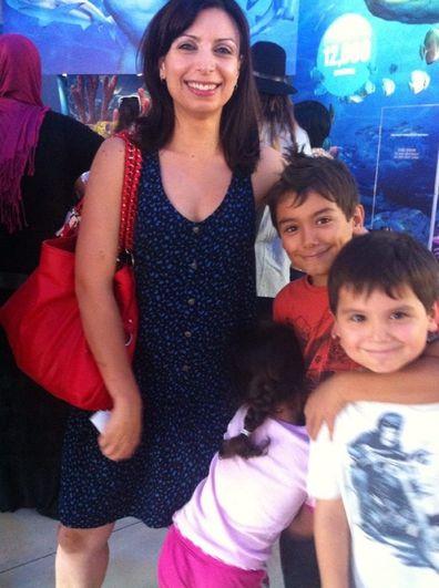 Jo Abi with three children