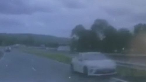 The coupe was seen on dashcam travelling the wrong way down a highway. (9NEWS)
