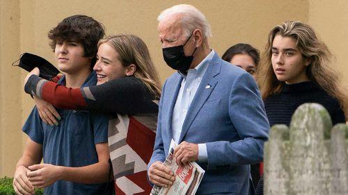 Joe Biden leaves church with some of his grandchildren on Sunday.