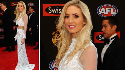 Amy Schultz bared her midriff as she joined husband Jay Schutlz of Port Adelaide at the Brownlow. (AAP)