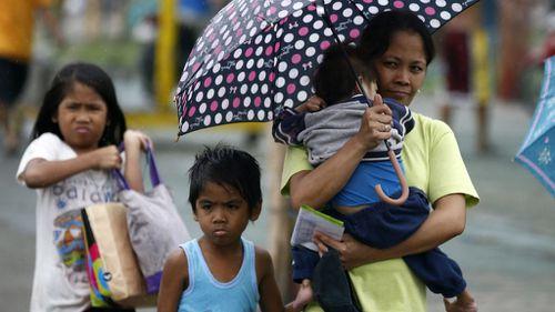 At least 23 dead as typhoon churns towards Philippine capital