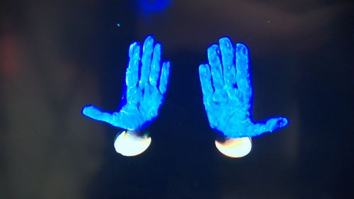 The machines illuminate the germs on human skin. (9NEWS)