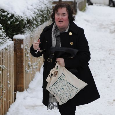 Susan Boyle arrives home in the snow as the United Kingdom is swept by snowstorms and blizzards on December 22, 2009 in Blackburn, Scotland.