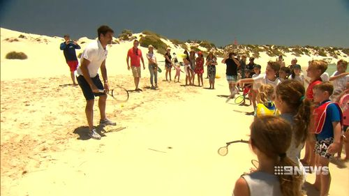 Federer took some time out to play tennis on the beach with some fans. (9NEWS)