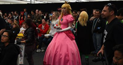 A cosplayer dressed as Princess Peach from the popular Mario Bros games. (AAP)