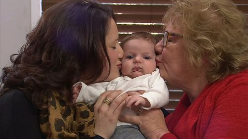 Ms Patten and Mrs Patten-Barwiese with their very special bundle of joy. (9NEWS)