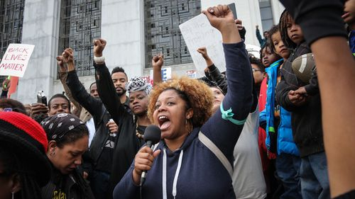 Thousands rally across US after police shooting deaths