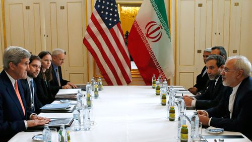 John Kerry, left, meets with Iranian Foreign Minister Mohammad Javad Zarif, right, in Vienna in 2016. (AAP)