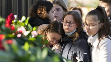 Students comfort each other as they gather outside the Perm State University following the campus shooting. (AP Photo/Dmitri Lovetsky)