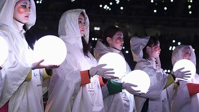 Performers hold globes of light at the closing ceremony. (AAP)