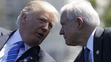 Donald Trump speaks to Jeff Sessions. (AAP)