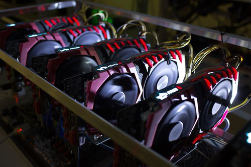A cryptocurrency mining rig composed of Asus Strix machines operates at the SberBit mining 'hotel' in Moscow, Russia.