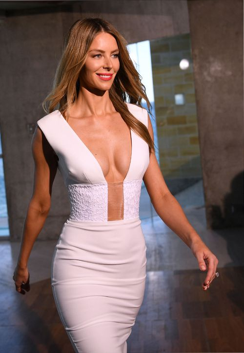Jennifer Hawkins wears a low-cut white outfit at today's Myer launch at Coogee.